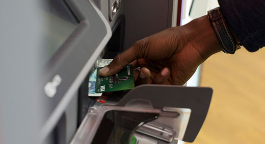 withdrawing cash from machine