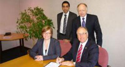Fiona Turner, Personnel Manager at ZF Lemforder UK ltd, and Terry somerfield, Managing Director, Standing L-R - Jatinder Sharma, Chief Executive of