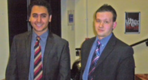 An image of two students who took part in a competition which tested their courtroom skills.