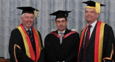 University Governor Professor Martin Chambers, Paul Mason, and Vice-Chancellor Professor Geoff Layer