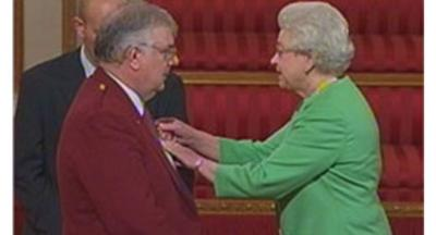 John Hay receives his MBE from the Queen